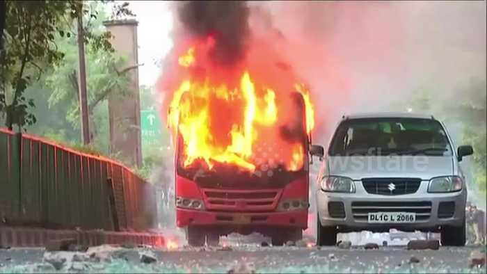 Protesters in Delhi torch buses and clash with police over citizenship bill