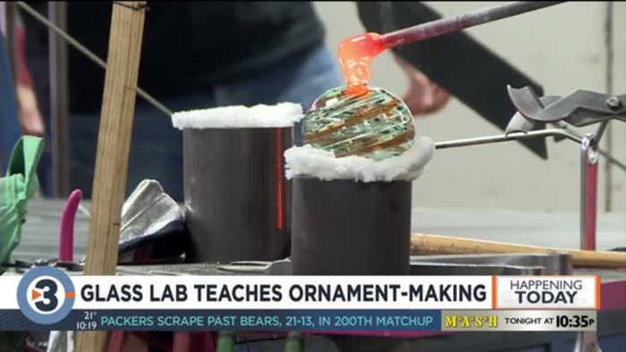 Interactive glass laboratory helps people create ornaments for upcoming holidays