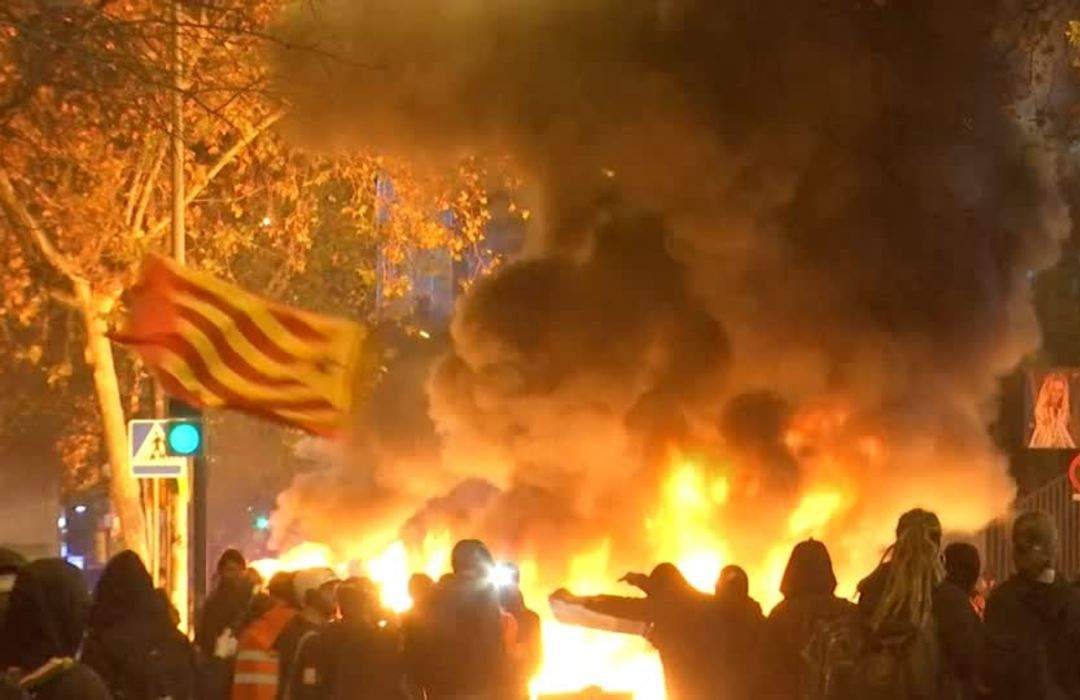 Fires rage as protesters attack police vans near Barca stadium