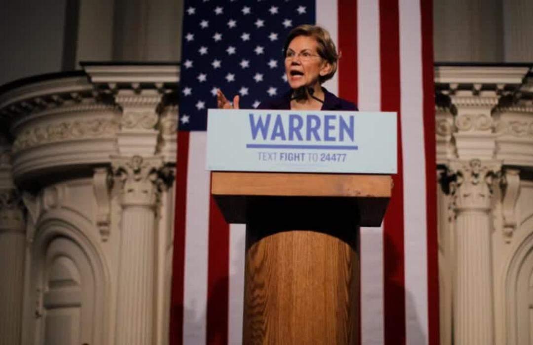 'Democracy hangs in the balance': Warren