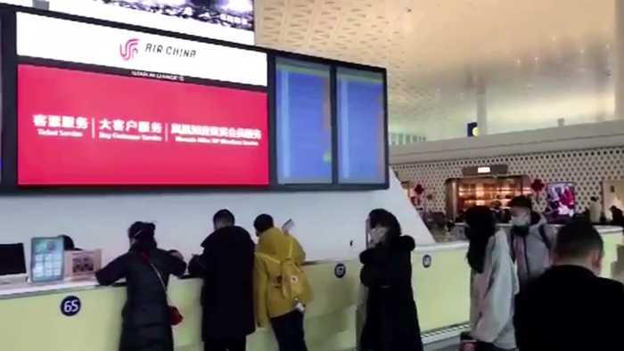 Traveller leaves Wuhan despite city lockdown after new virus outbreak