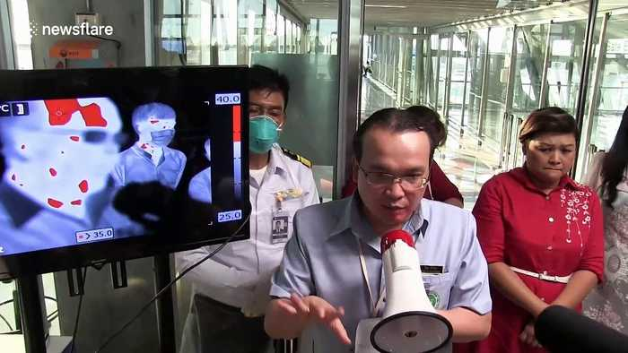 Thai airport screens passengers for coronavirus as country confirms fifth case of the illness