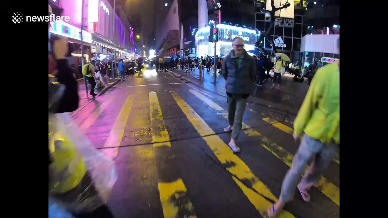 Mong Kok protesters hurl projectiles at Hong Kong riot police on first day of Lunar New Year