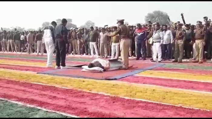 Indian police officer lets vehicles drive over his stomach