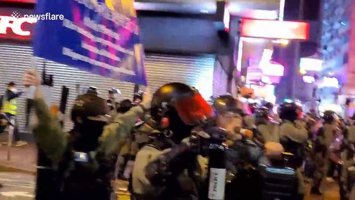 Hong Kong riot police fire pepper rounds at bystanders next to last remaining new year market