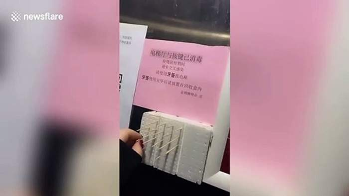 Toothpicks provided in lift so Chinese residents don't have to touch buttons to prevent spread of coronavirus