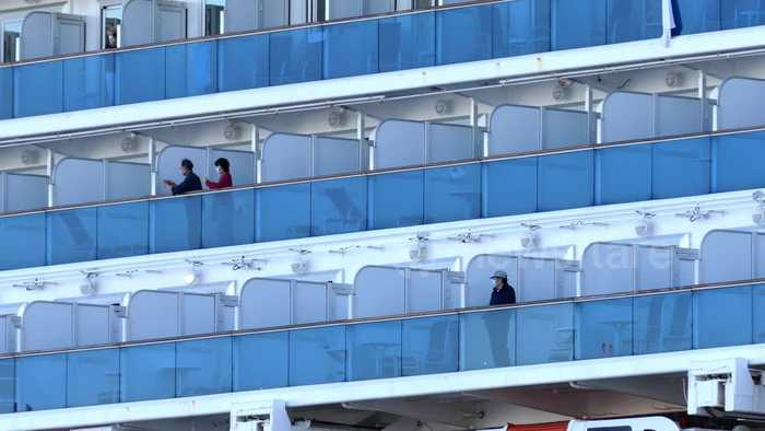 Passengers seen on Diamond Princess cruise ship ahead of authorised disembarkation