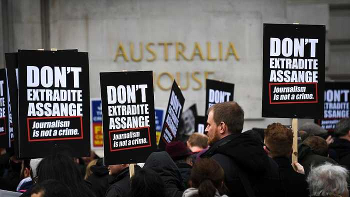 Protesters march for Assange's release