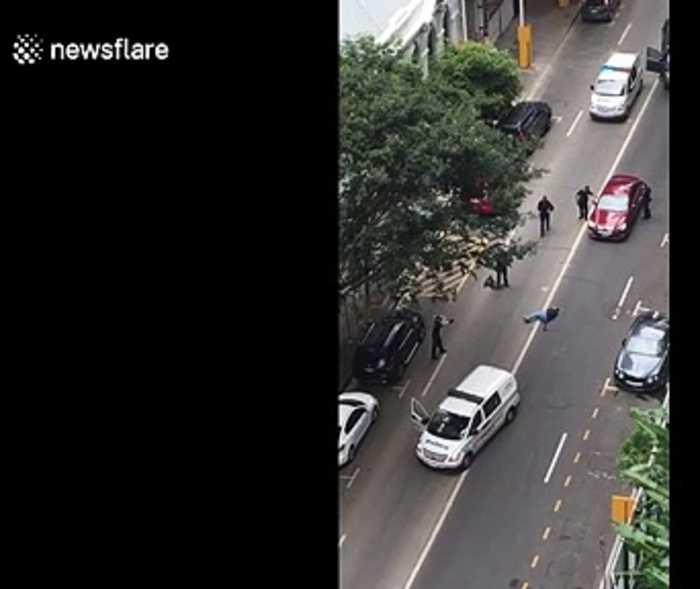 Australian police shoot dead stabbing suspect in central Brisbane