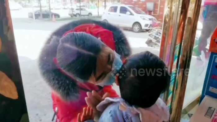 Coronavirus nurse kisses son through glass window after not seeing him for 26 days