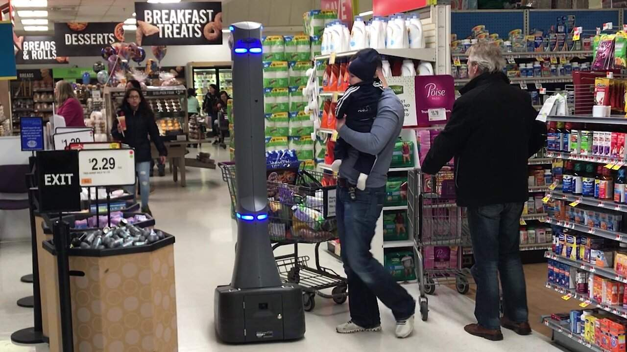Customers suspicious of high tech security robot patrolling New York supermarket