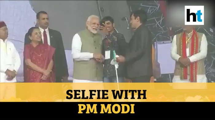 Watch: Youth clicks selfie with PM Modi on stage in Prayagraj