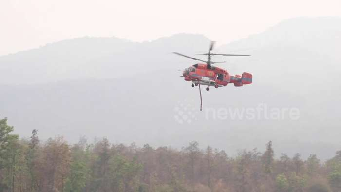 Helicopters dump water on forest fires ravaging northern Thailand
