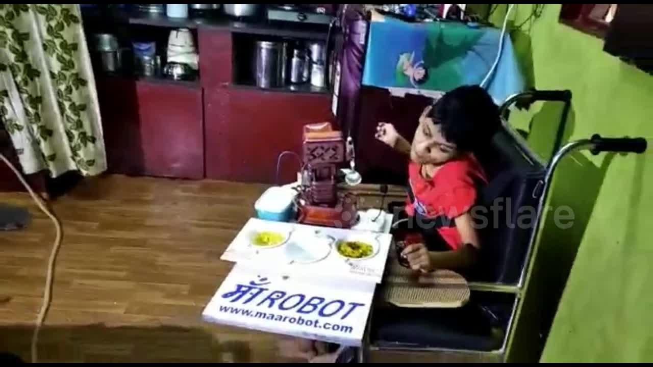 School dropout father in India builds robot to help feed his daughter with cerebral palsy