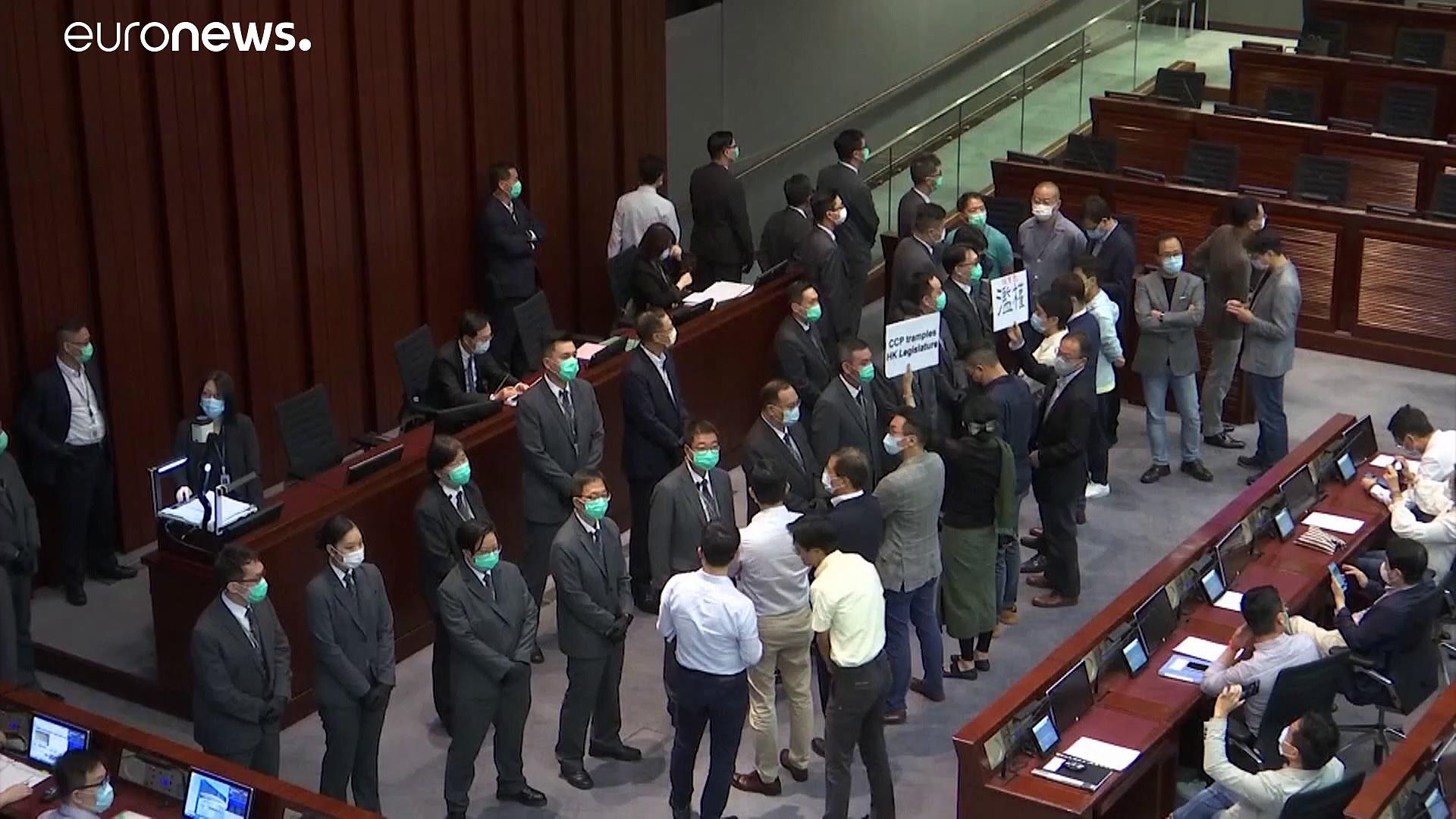 Clashes in Hong Kong's legislature after pro-Beijing lawmaker elected to lead key committee