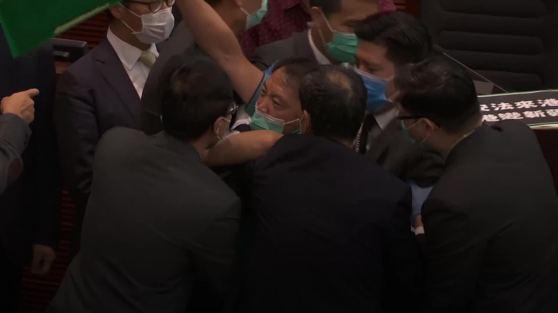 Scuffles break out between Hong Kong legislators over security freedoms