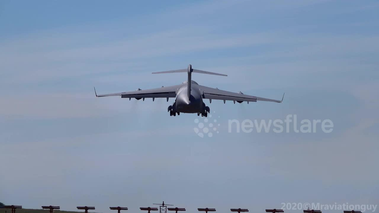 Extreme jet blast from an Royal Air Force Boeing C-17 Globemaster as it performs go around manoeuvre at Bristol Airport, UK