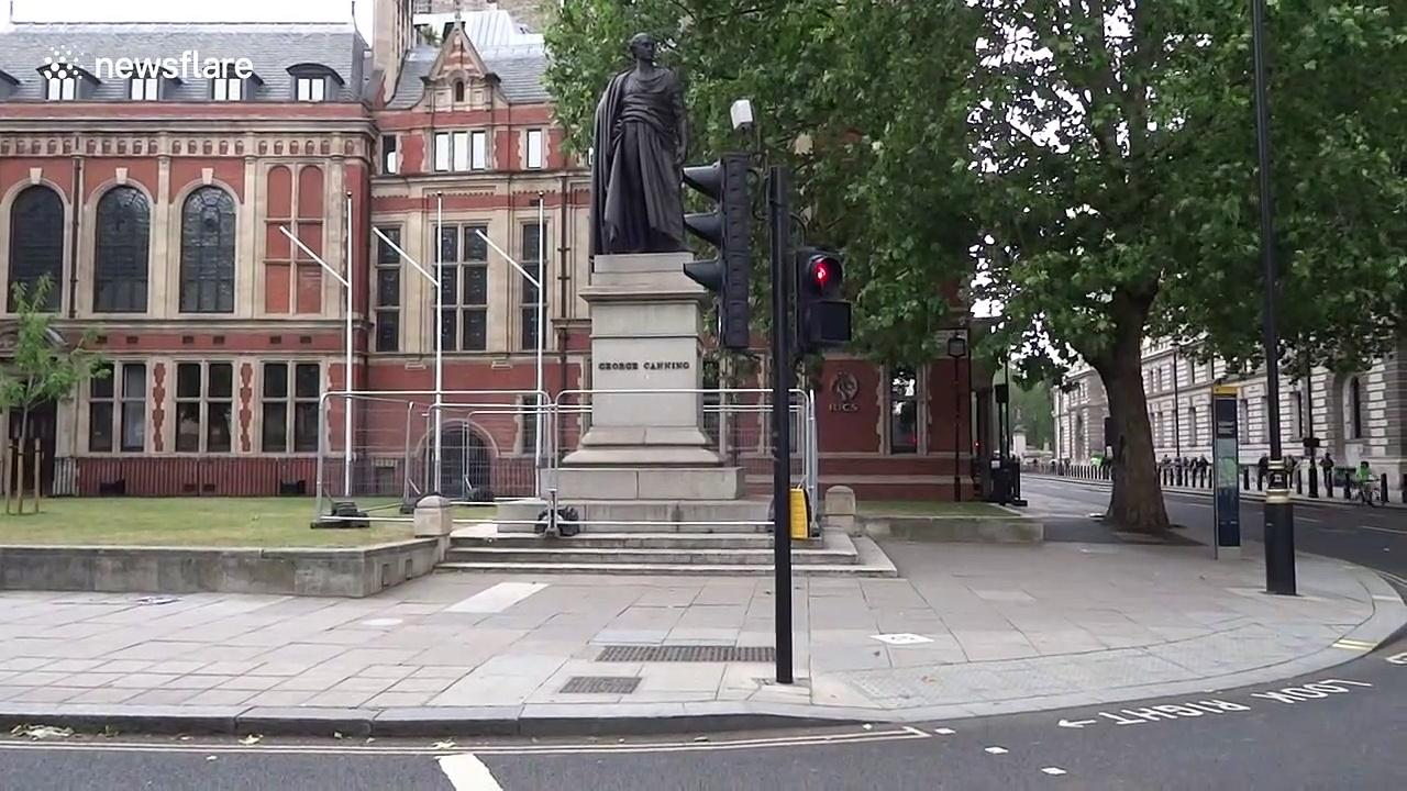 George Canning statue in scaffolding and Winston Churchill monument boarded up ahead of BLM protests in central London