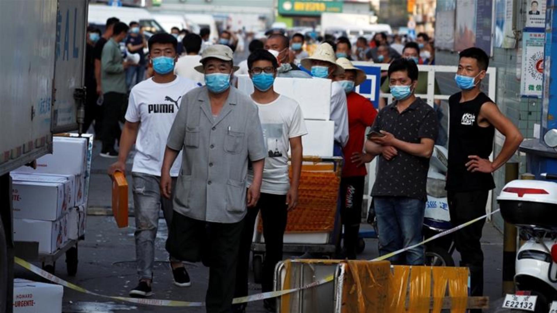 Beijing district in 'wartime mode' amid fresh coronavirus cases