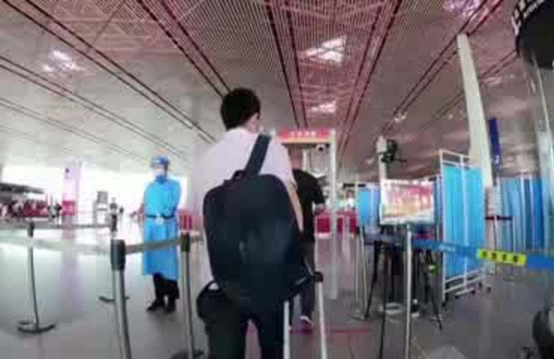 Beijing cuts flights to contain new virus outbreak