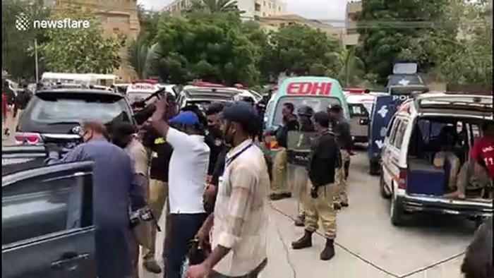 Video of car used by gunmen outside Pakistan stock exchange building in Karachi