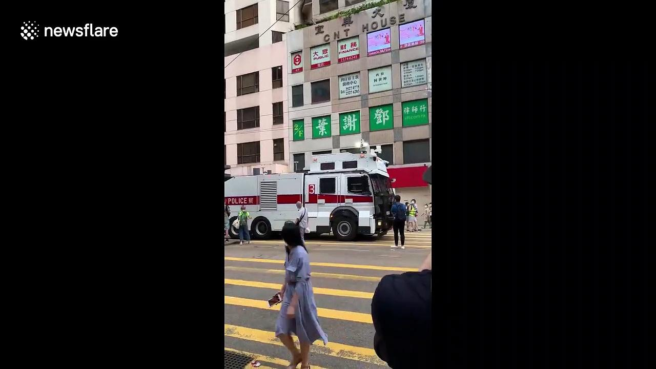 'Brave' Hongkonger gives middle finger to water cannon truck during security law protest