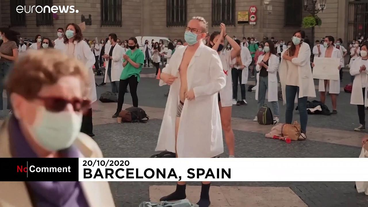 Young doctors in Barcelona take off clothes to highlight concerns