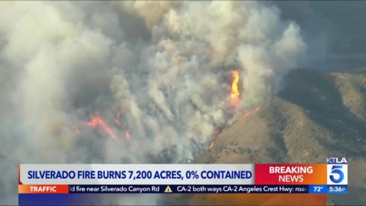 Two firefighters critically injured as 7,200-acre blaze forces thousands to evacuate Southern California