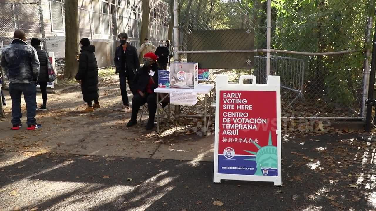 Long lines form outside early voting location in Manhattan