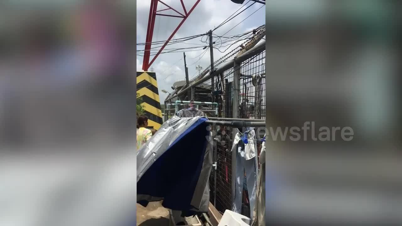 Terrifying moment oil tanker ship crashes into homes along river bank in Thailand