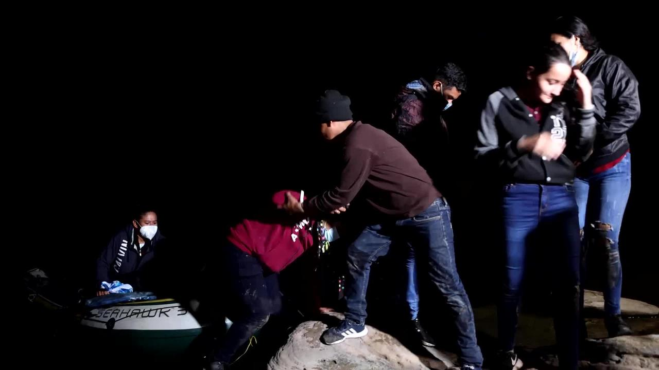 Emotional moment migrants arrive in the USA for the first time after crossing Mexican border.