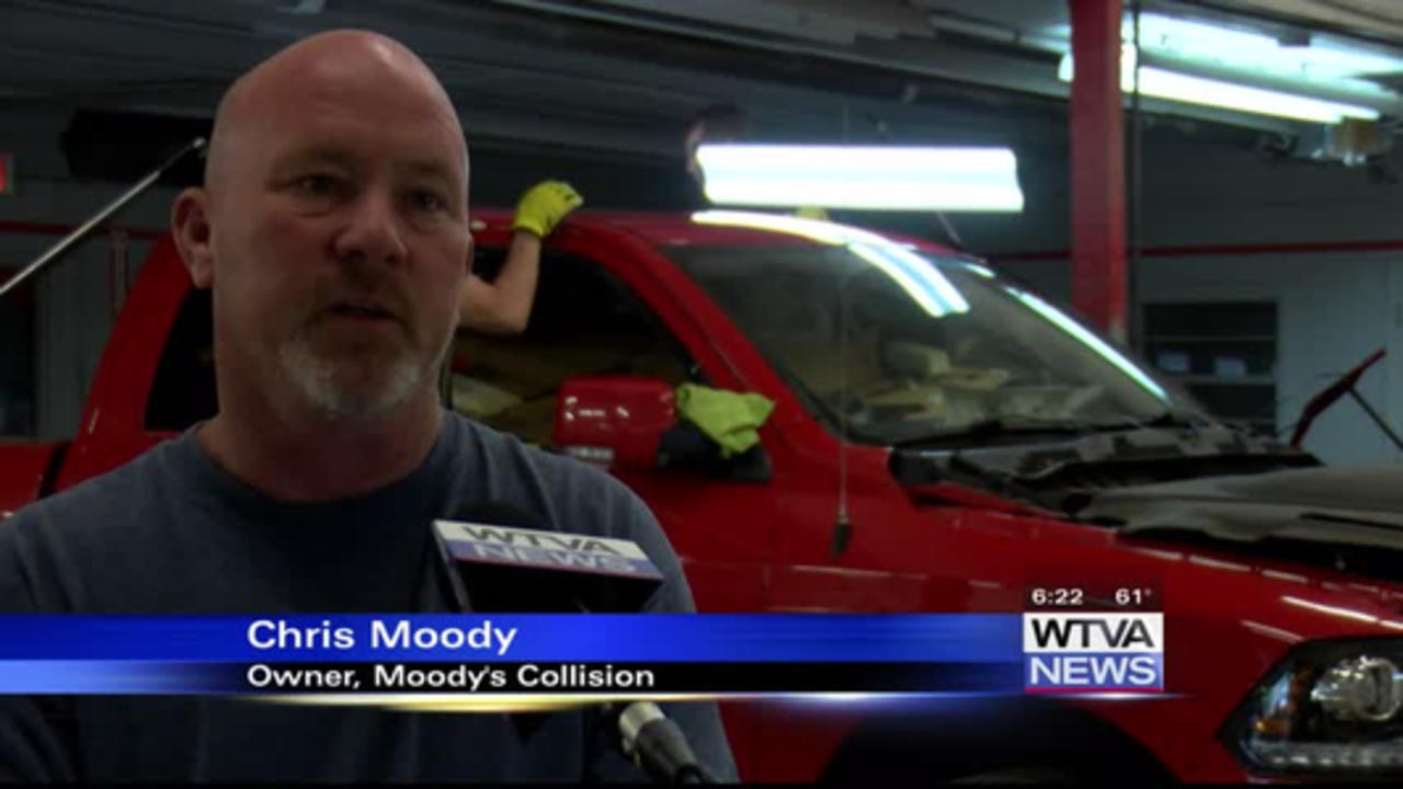 Collision repair shop busy with hail damage