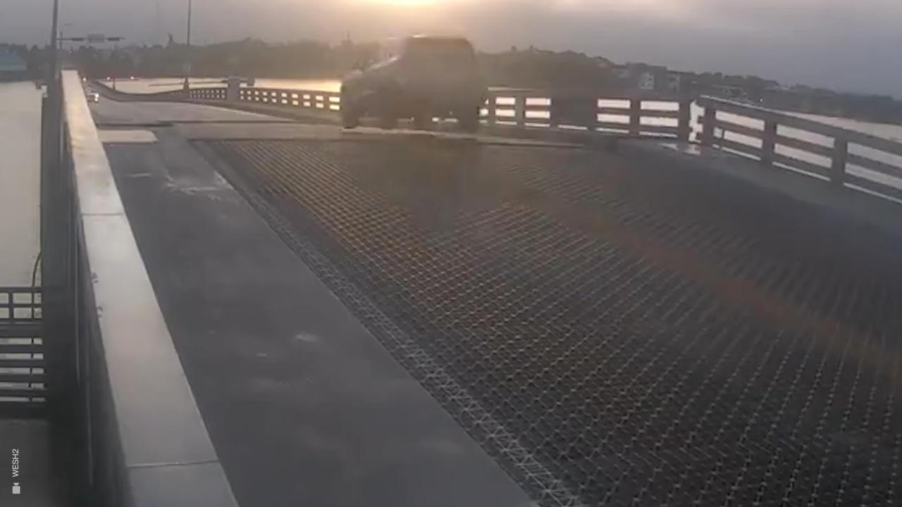 Driver caught jumping over rising drawbridge after smashing through barrier
