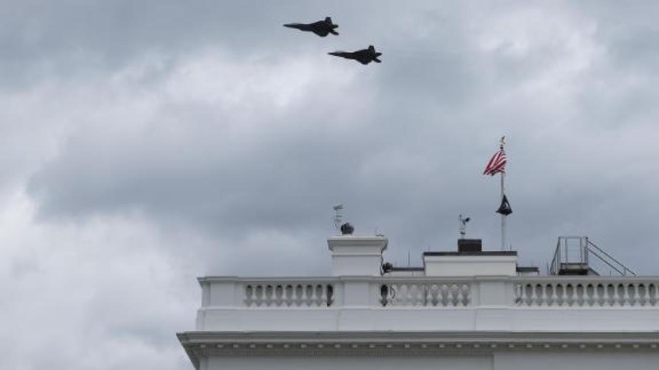 Watch military flyover interrupt a White House briefing
