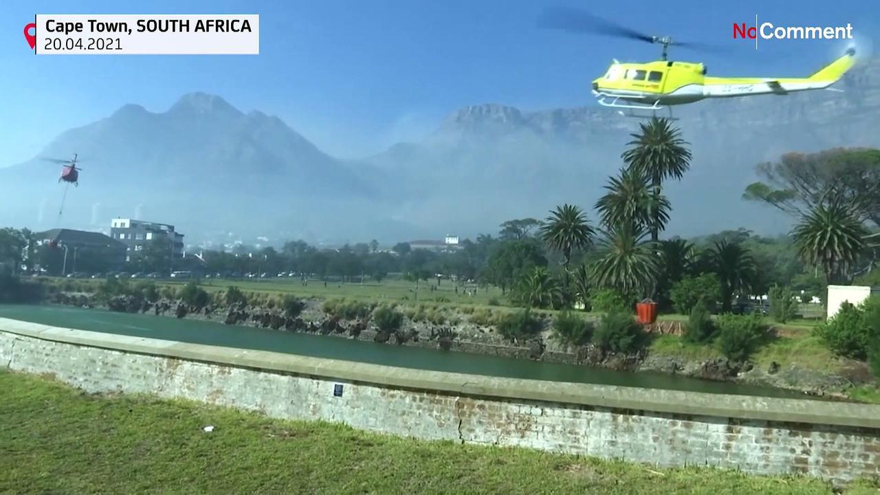 Crews work to extinguish wildfire on Table Mountain