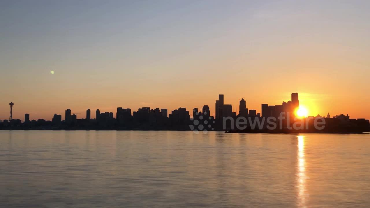 Watch this spectacular time-lapse footage of a stunning spring sunrise over downtown Seattle