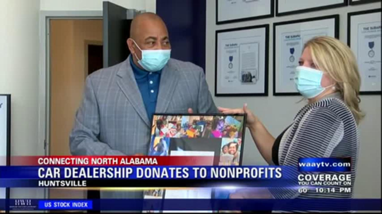 Two local non-profits receive donation from Huntsville car dealership