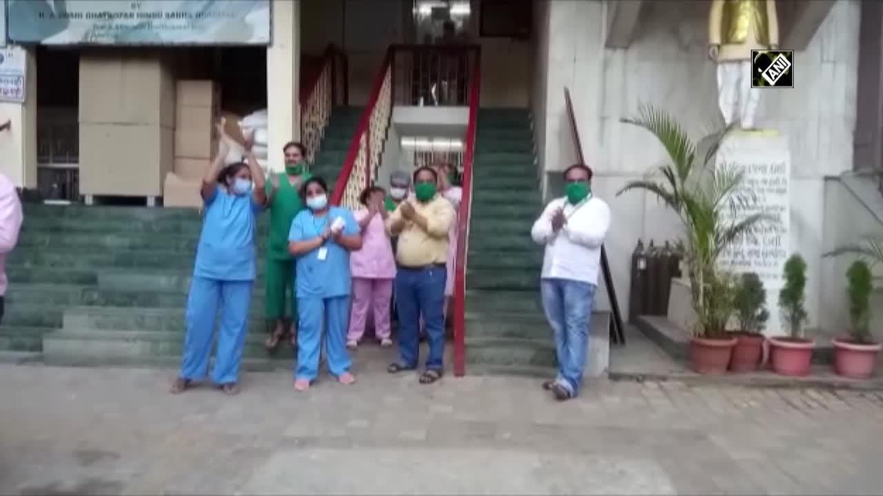 Indian hospital staff celebrate when oxygen tanks arrive in nick of time