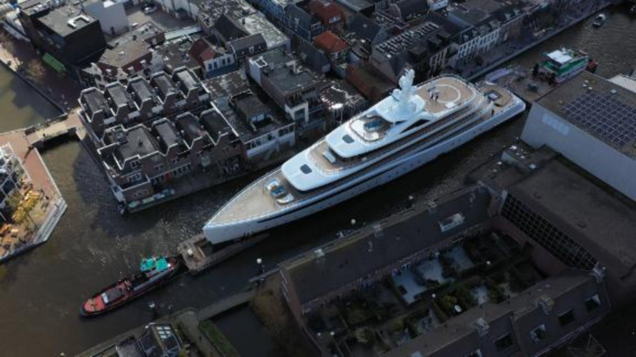 See superyacht squeeze through narrow canals