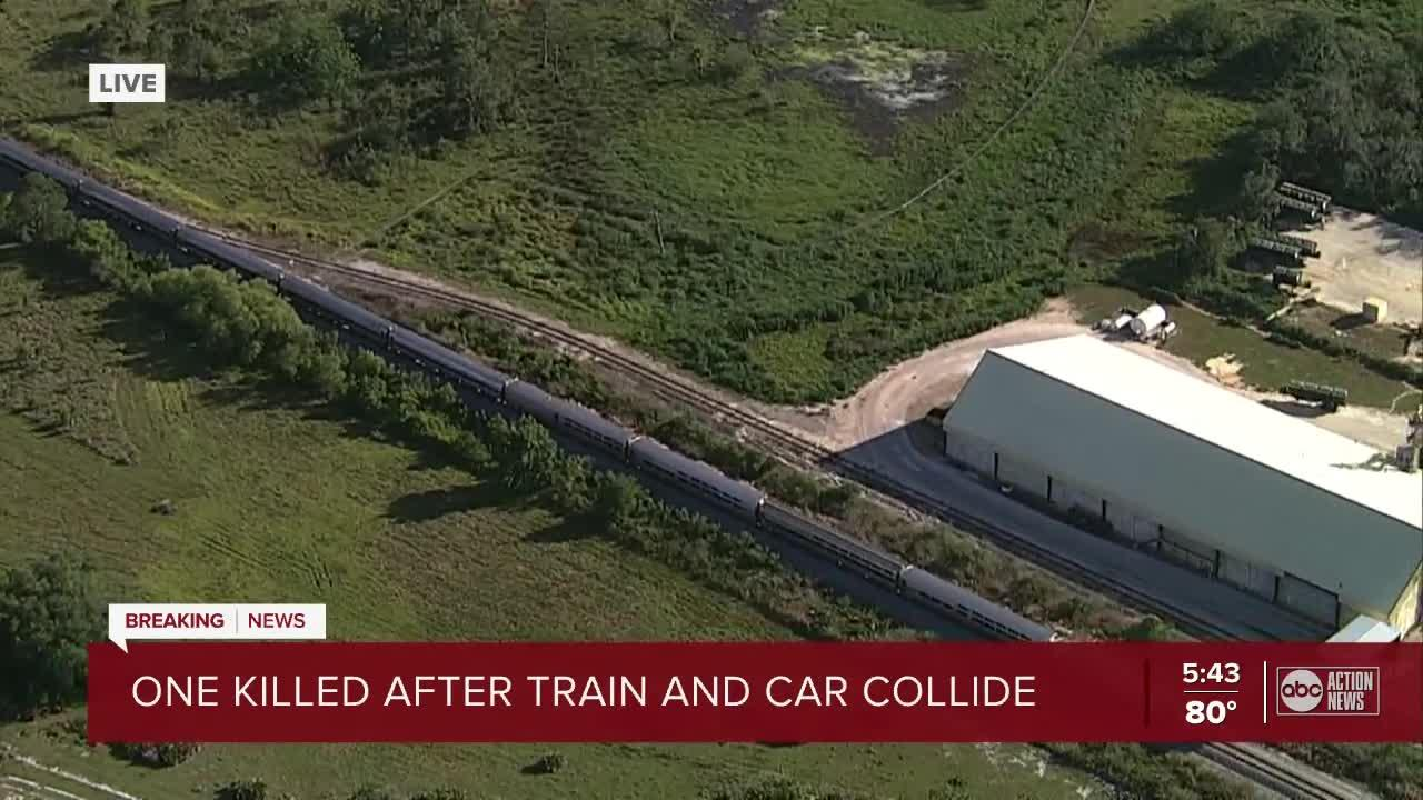 1 killed, another person transported to hospital after train-car crash