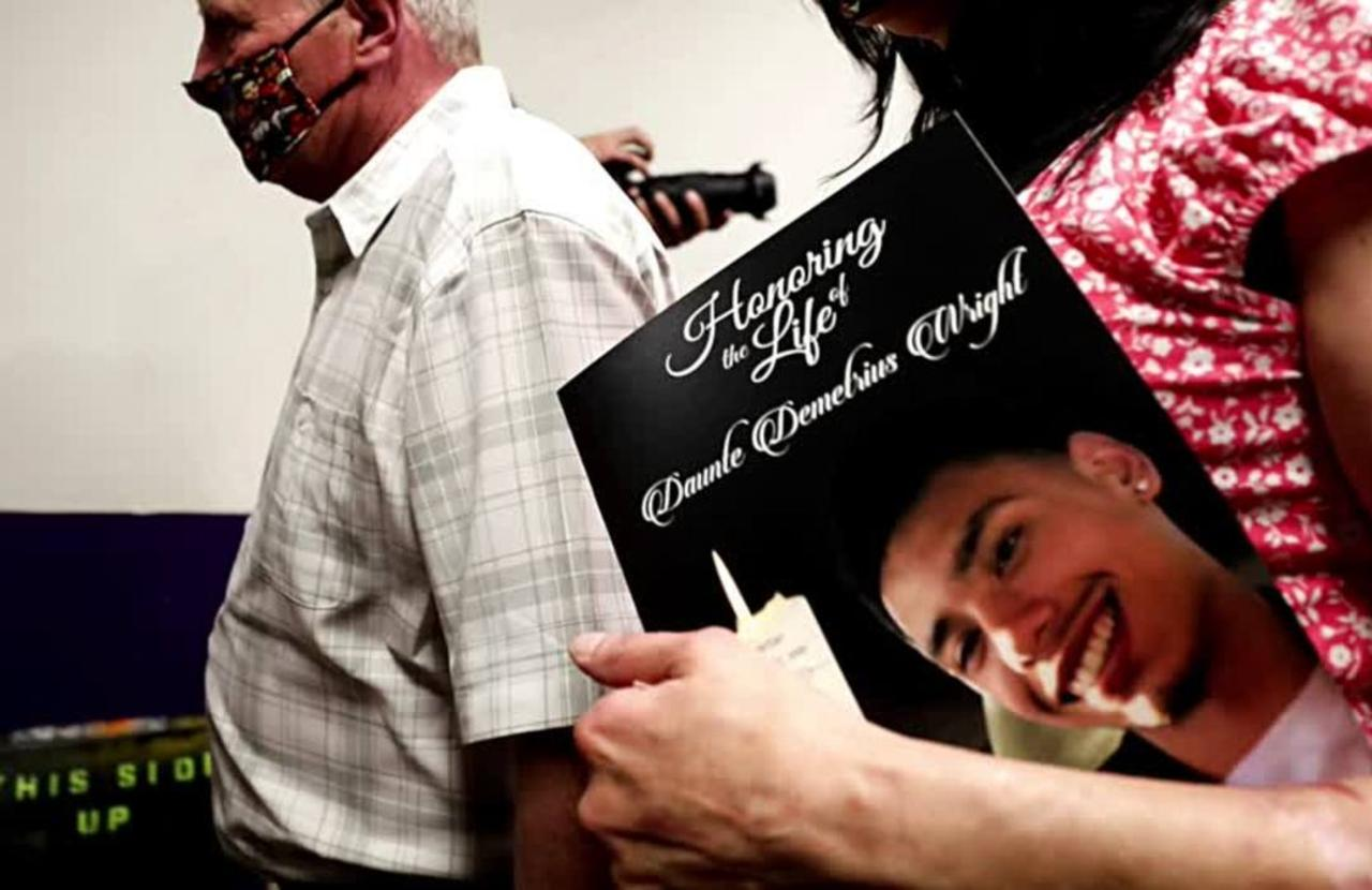 A smile 'worth a million dollars': Wright laid to rest