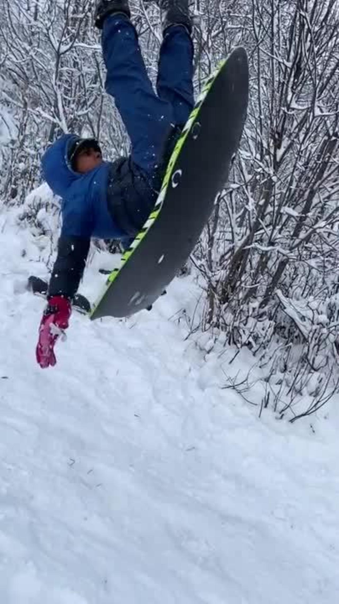 Kid Sledding Down Snowy Slope Falls Over Backwards