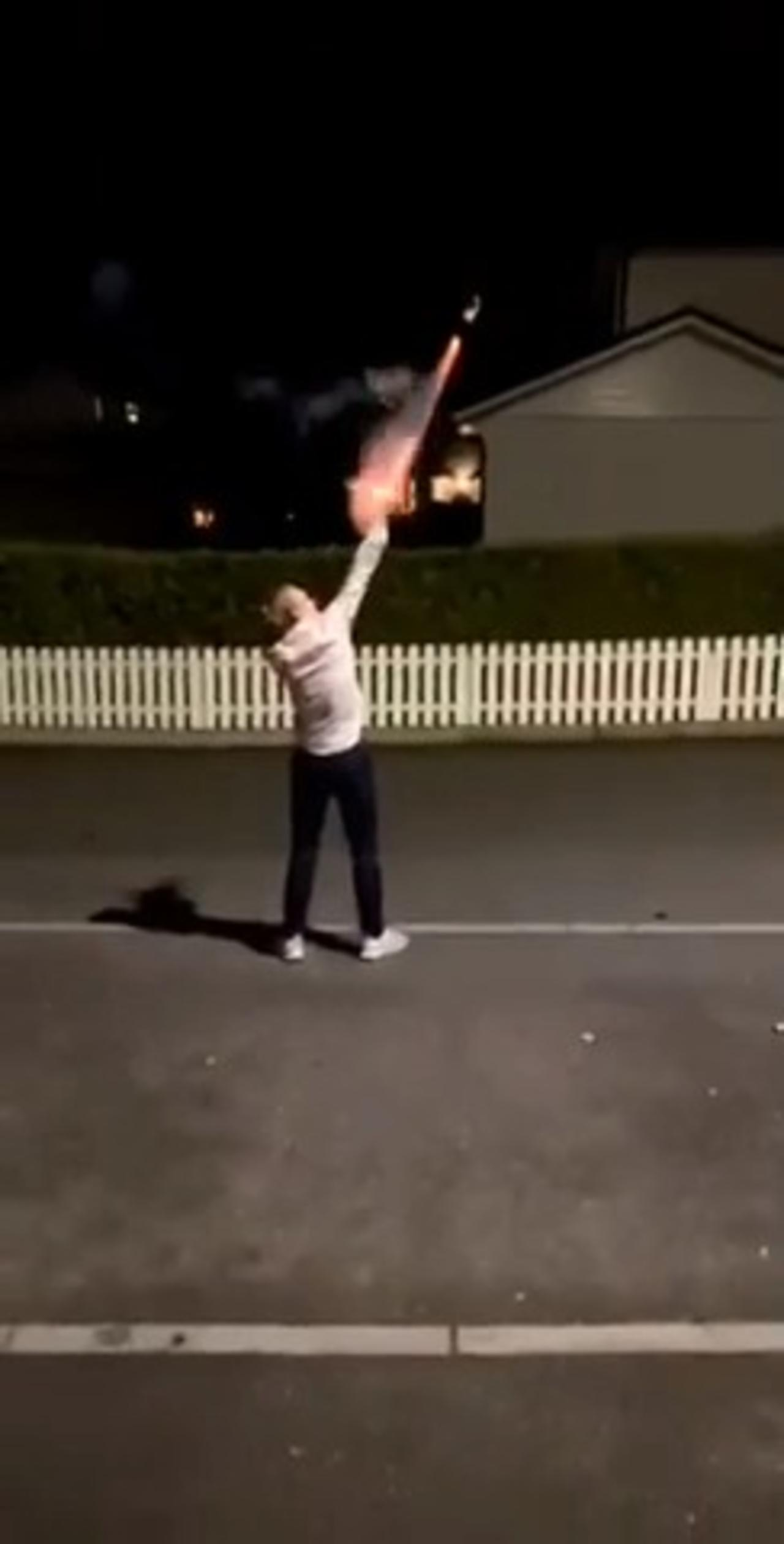 Fire Hits Guy's Face While He Tries to Light Fireworks in His Hand