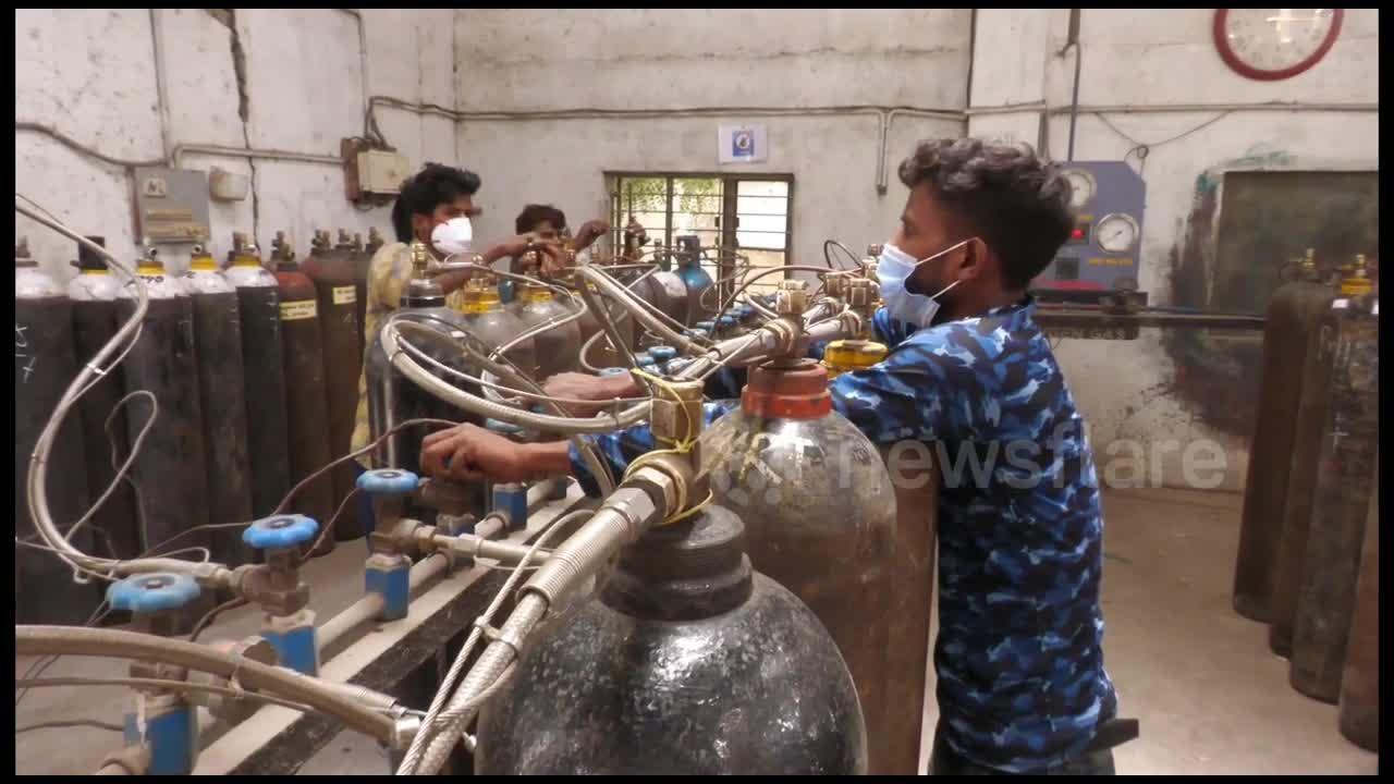 Residents in India rush to refill oxygen cylinders in attempt to save loved ones with COVID-19