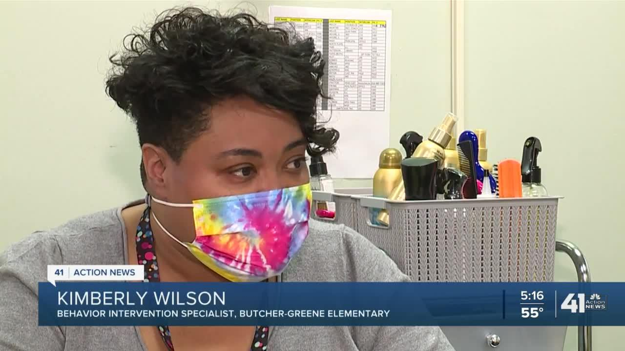 Educator works to boost students' self esteem through hair cuts