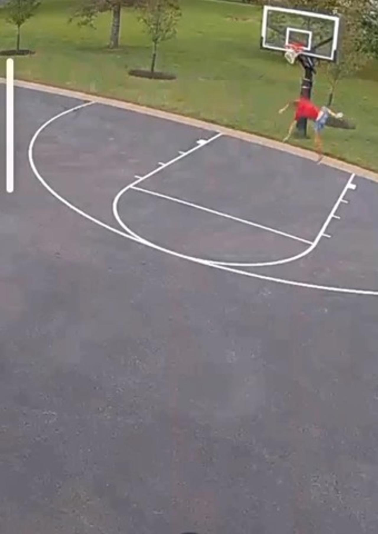 Man Falls on His Stomach While Trying to Hang on Basketball Hoop