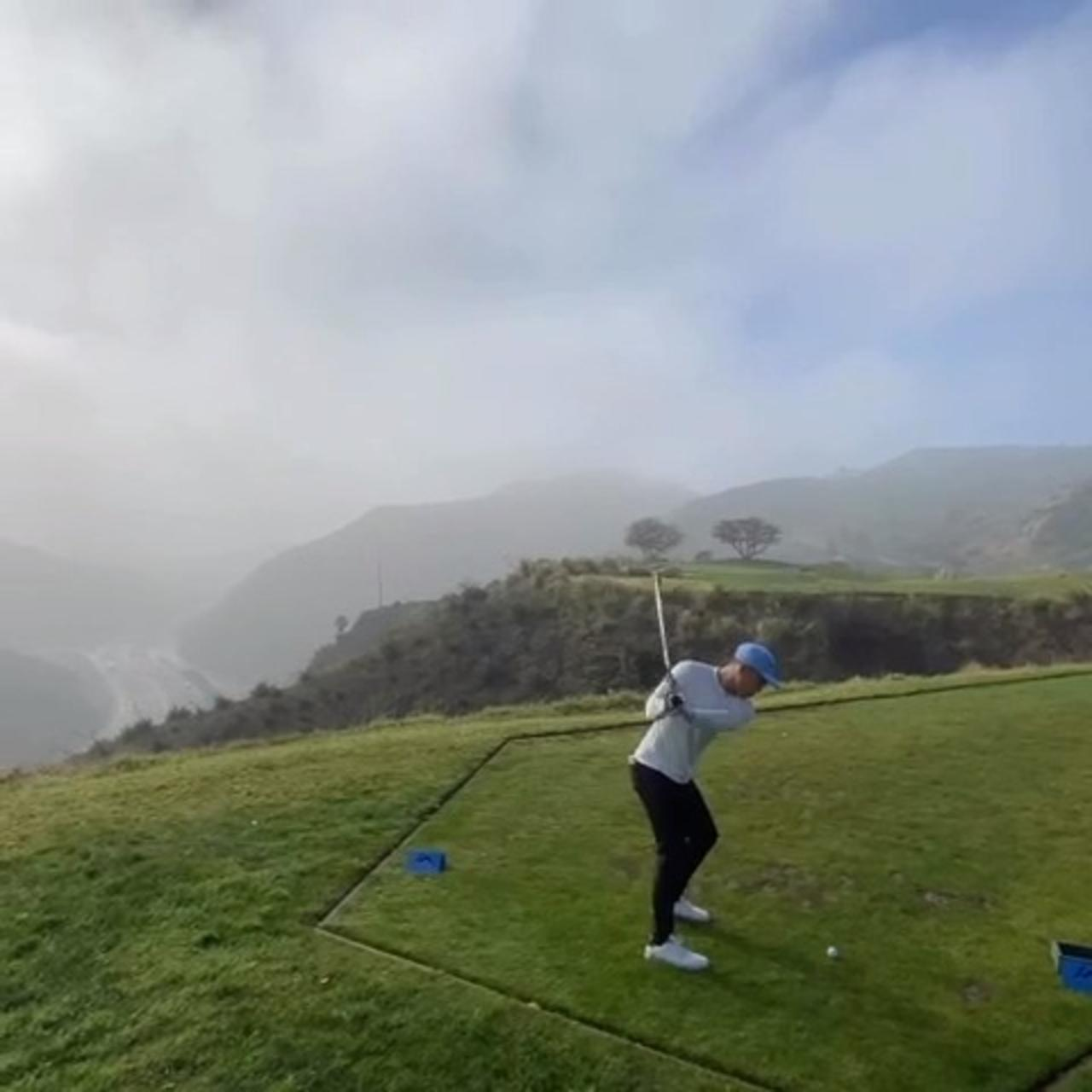 Golf Club Slips Out of Guy's Hands While He Tries to Take Shot