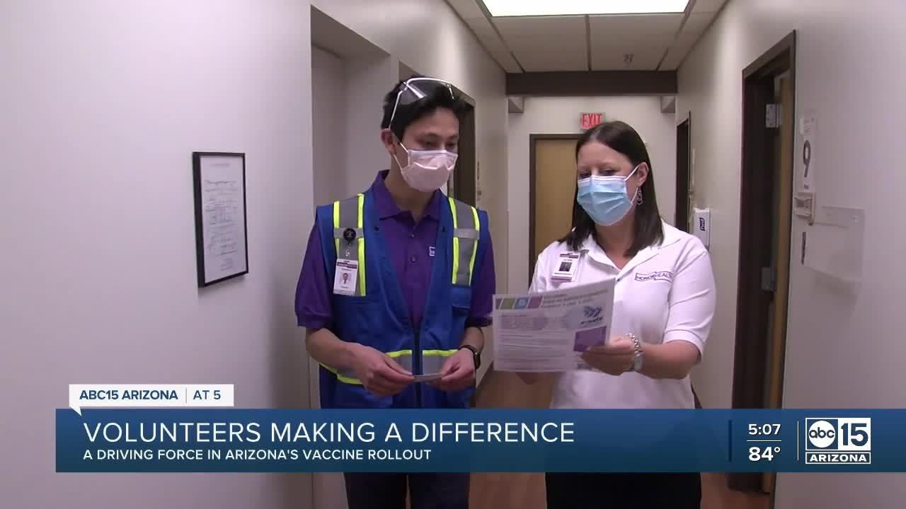 Volunteers playing a big role behind the scenes at vaccination sites