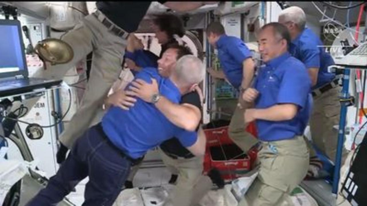 Hugs as SpaceX crew boards space station