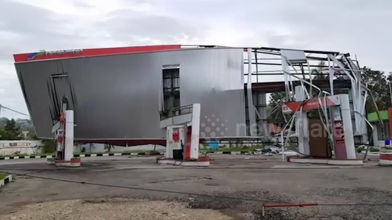Indonesia Cyclone Seroja aftermath leaves garage damage